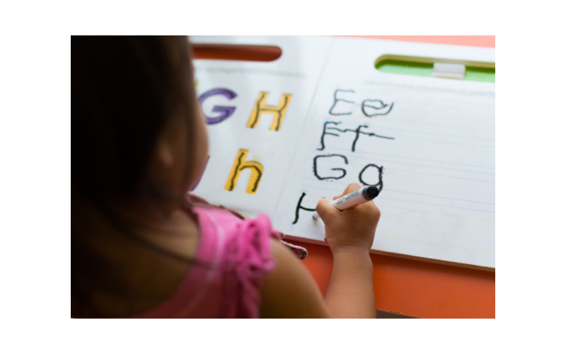 Child writing as a home learning activity