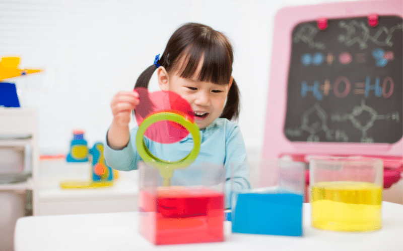 preschooler doing fun activity to learn primary colors